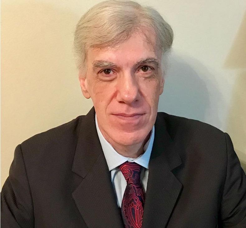 Dr. Claudio Corradino